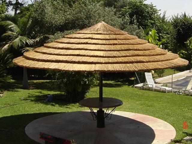 Pergolas de madera sombrillas de brezo junco africano for Sombrillas terraza